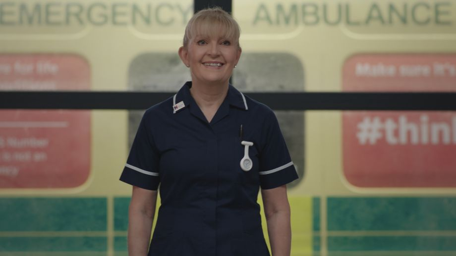 Cathy Shipton as Duffy in Casualty. Smiling and looking directly at camera
