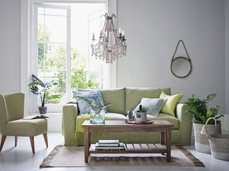 Green living room by Marks and Spencer