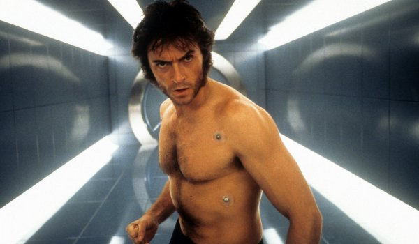 X-Men Hugh Jackman shirtless in the hallway leading to Cerebro