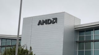 The AMD logo on a building on the AMD campus.