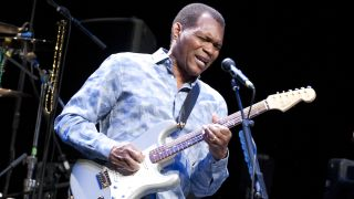 Robert Cray playing guitar onstage