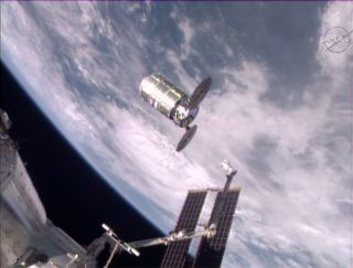 The unmanned Cygnus cargo ship Deke Slayton II departs the International Space Station at the end of its resupply mission. The robotic spacecraft will be commanded to intentionally burn up in the Earth's atmosphere for disposal.