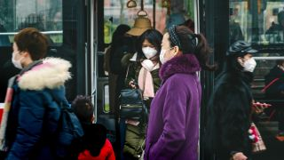 Commuters in Chengdu, China, don face masks amidst the coronavirus outbreak, on Jan. 23, 2020.