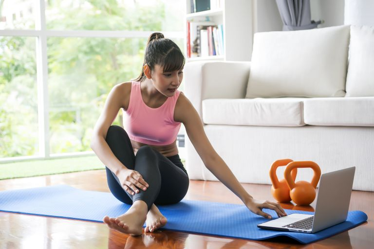 woman working out at home with storage bench