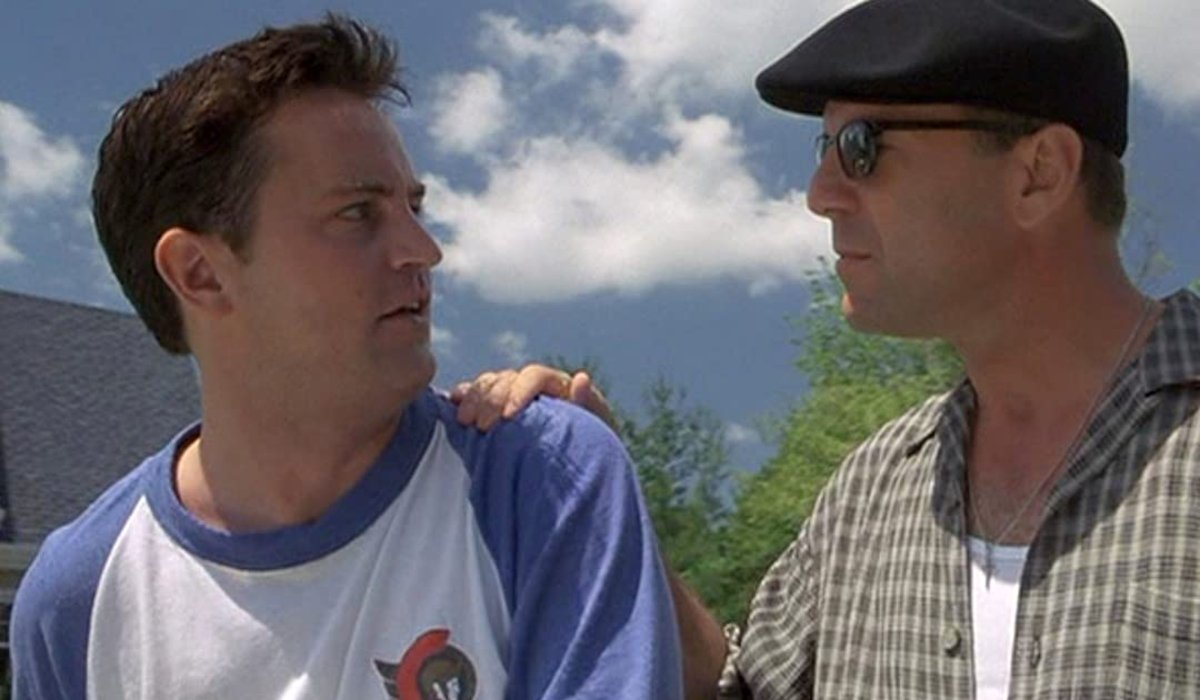 Bruce Willis puts his hand on Matthew Perry's fearful shoulder in The Whole Nine Yards.