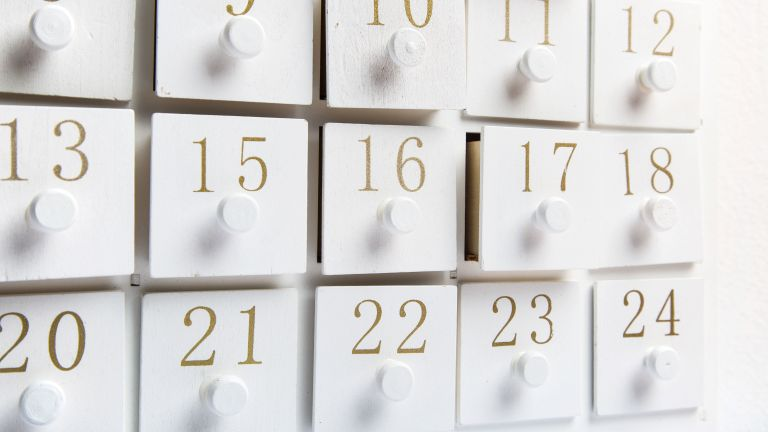 white advent calendar with gold numbers by getty images