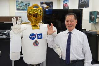 George Takei (Star Trek's Sulu) and Robonaut throwing the Vulcan salute during a visit to NASA Johnson Space Center.