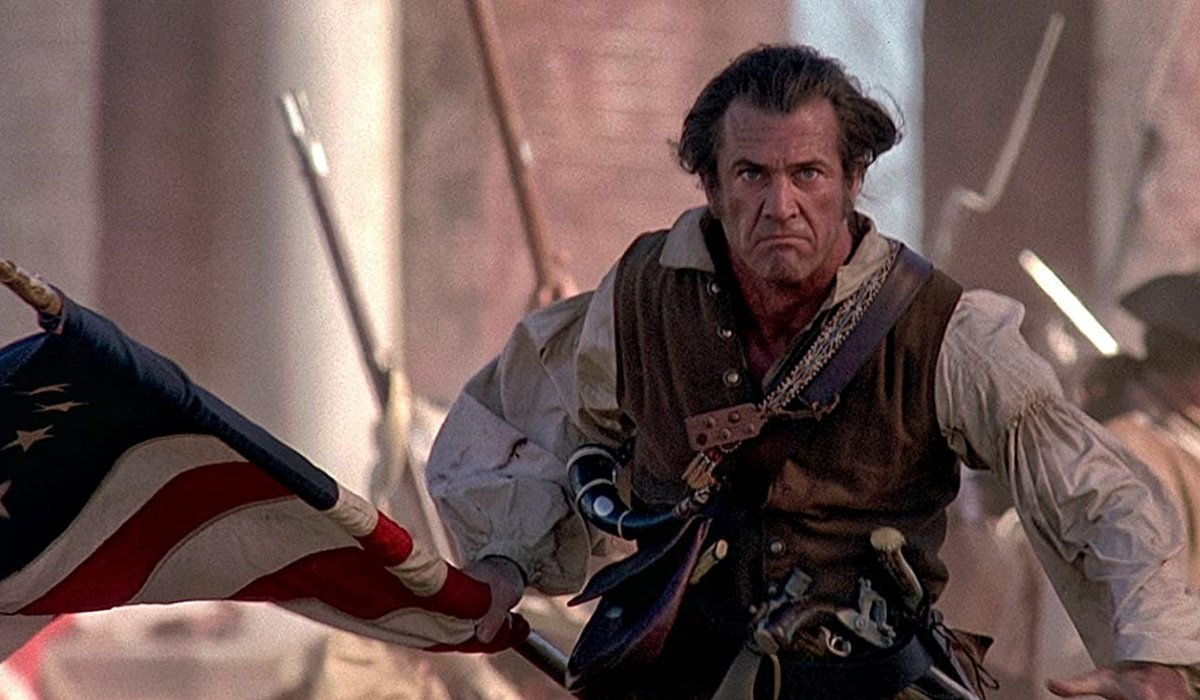 The Patriot Mel Gibson rampages with a flag
