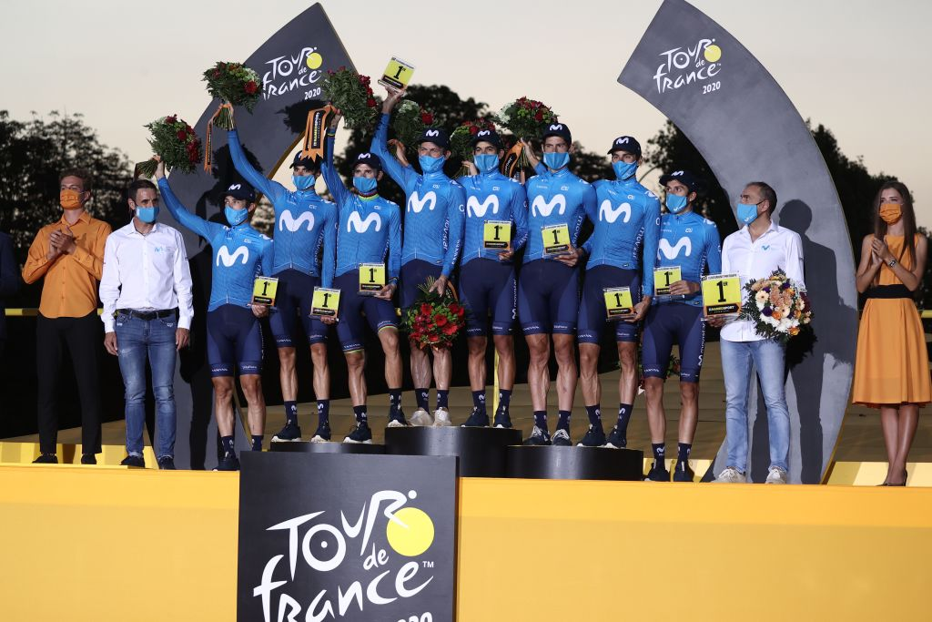 Team Movistar riders celebrate winning the teams overall ranking at the end of the 21st and last stage of the 107th edition of the Tour de France cycling race 122 km between ManteslaJolie and Champs Elysees Paris on September 20 2020 Photo by KENZO TRIBOUILLARD AFP Photo by KENZO TRIBOUILLARDAFP via Getty Images