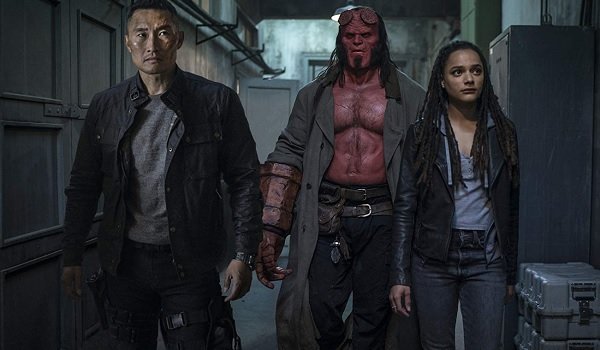 Hellboy and his fellow agents investigate a hallway