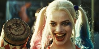 Harley Quinn licks her teeth while holding a mallet in 'Suicide Squad'