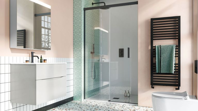 green and pink bathroom with large shower and towel rail