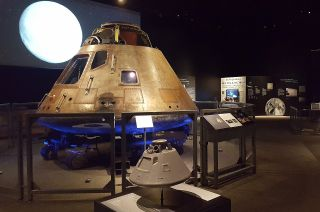 "A sensory-assistive scale model of the Apollo 11 command module sits before the real ""Columbia"" as part of the ""Destination Moon: The Apollo 11 Mission"" exhibition at the Cincinnati Museum Center in Ohio, open to the public through February 2020."