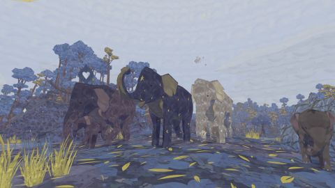 Three elephants surrounded by blue trees