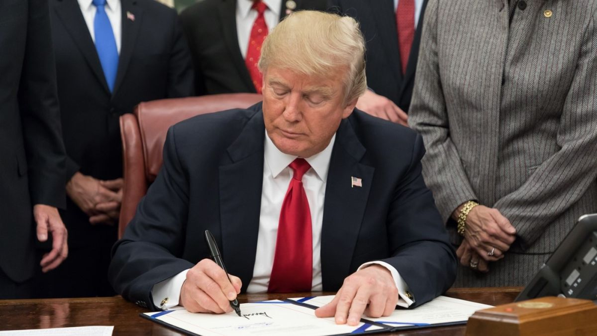 Trump order bans US firms from dealing with Huawei