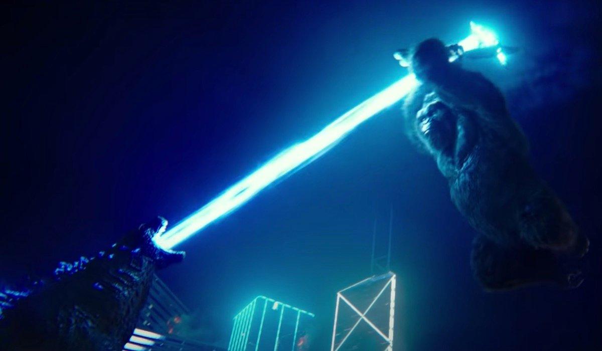 Godzilla shooting atomic breath at axe-wielding Kong Kong