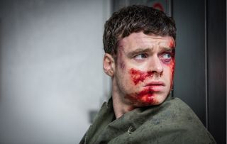 Richard Madden covered in blood as David Budd in the final episode of Bodyguard