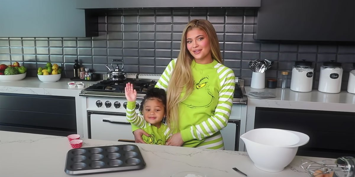 Kylie Jenner & Daughter Stormi Wear Matching Grinch Pajamas For Holiday Baking Video