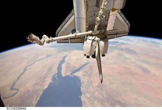 Astronauts Pack Up Shuttle Cargo Pod, Inspect Heat Shield
