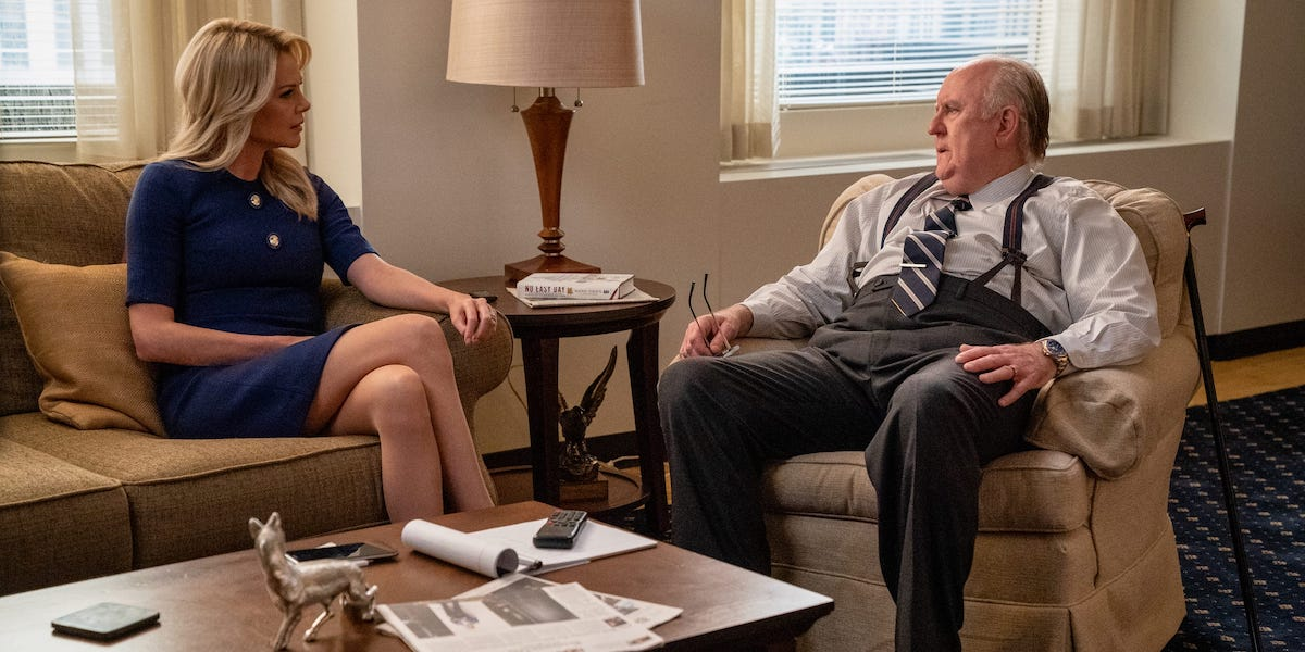 Charlize Theron as Megyn Kelly and John Lithgow as Roger Ailes in Bombshell