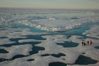 Aerial view of researchers working on Arctic sea ice.