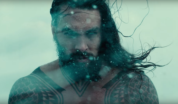 Jason Momoa's Aquaman being splashed with water