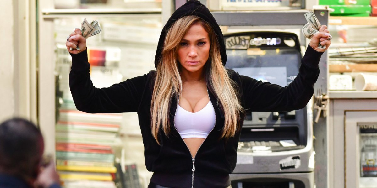 Hustlers J Lo with her hands up, and full of money
