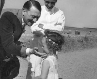 Hitler with a daughter of Reich Minister of Propaganda Joseph Goebbels, 1933 (killed by her parents the day they both committed suicide).