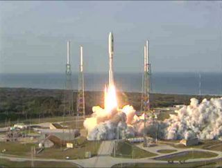 This still from a United Launch Alliance broadcast shows an Atlas 5 rocket launching into space with the U.S. Navy's MUOS-1 communications satellite on Feb. 24, 2012. Liftoff occured at 5:15 p.m. ET (2215 GMT) from the Cape Canaveral Air Force Station.