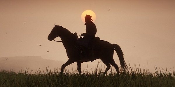 A cowboy rides across the prairie in Red Dead Redemption 2.