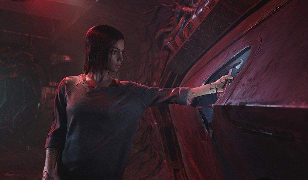 Alita: Battle Angel Alita manipulating a hatch control in the wall