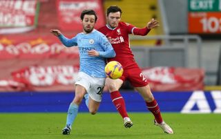 Bernardo Silva and Andy Robertson battle for the ball