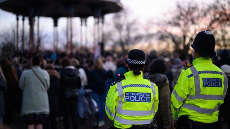 Police and members of the public at Sarah Everard vigil