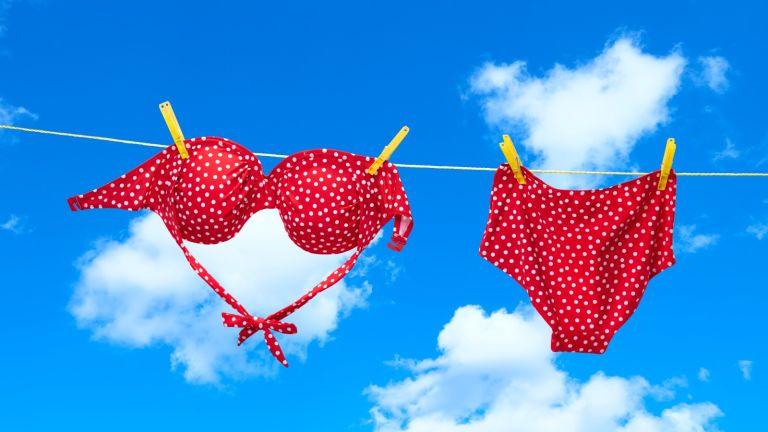 Wearing bikini top upside down, Red spotty bikini hanging on clothes line