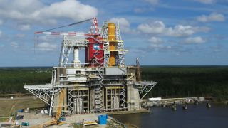 The first flight core stage of NASA's new Space Launch System (SLS) is seen here, installed on the B-2 Test Stand at NASA's Stennis Space Center in Mississippi.