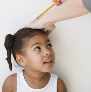 Child getting measured.
