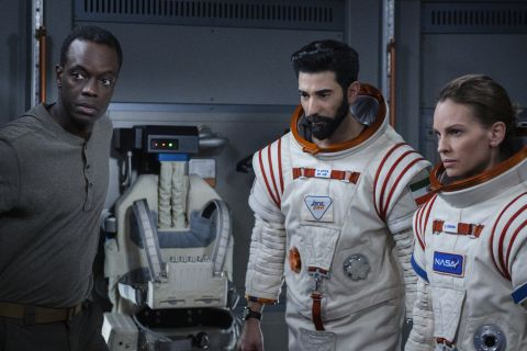 Emma (Hilary Swank), Ram (Ray Panthaki), and Kwesi (Ato Essandoh) ponder the dangers of their mission.