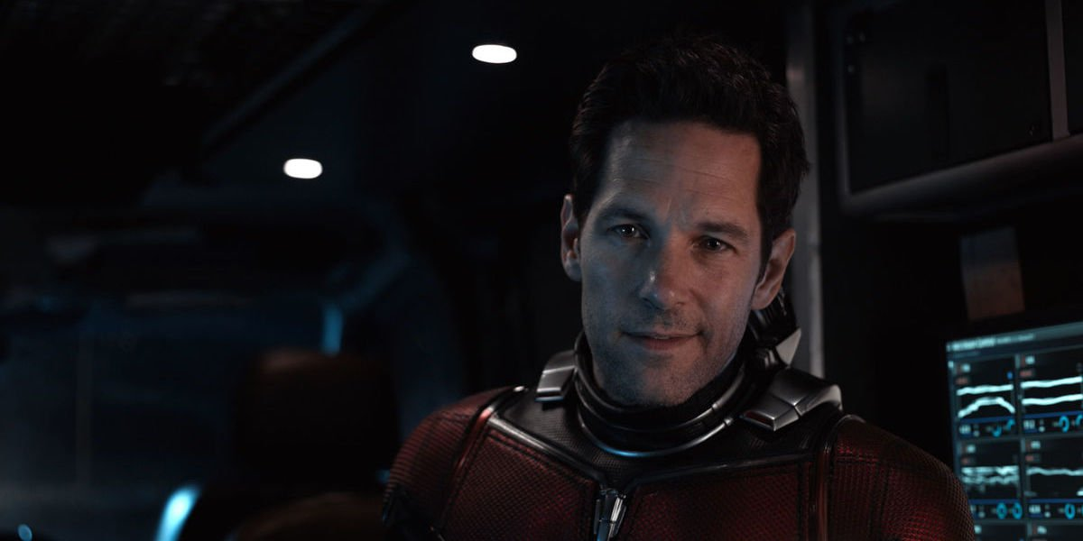 Scott Lang smiles from the control room while wearing his Ant-Man suit.