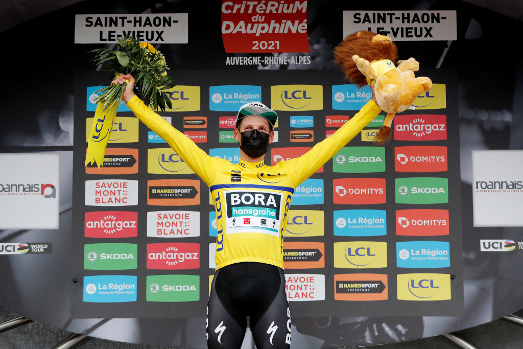 SAINT HAON LE VIEUXON FRANCE JUNE 01 Lukas Pstlberger of Austria and Team Bora Hansgrohe yellow leader jersey celebrates at podium during the 73rd Critrium du Dauphin 2021 Stage 3 a 1722km stage from Langeac to Saint Haon Le Vieuxon Covid safety measures Mascot UCIworldtour Dauphin dauphine June 01 2021 in Saint Haon Le Vieuxon France Photo by Bas CzerwinskiGetty Images