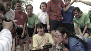 A seemingly coloured photo of a group of teenagers.