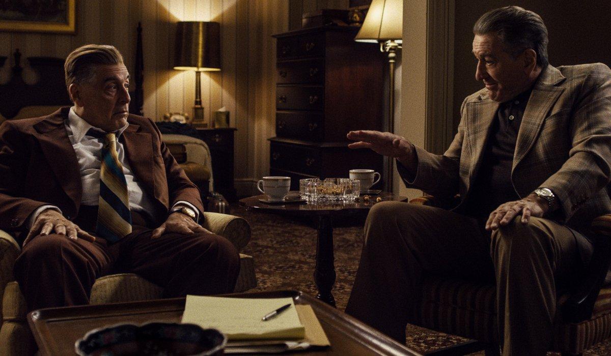 The Irishman Al Pacino and Robert DeNiro sitting in the living room, talking
