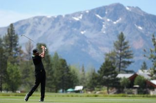 Former NBA athlete Dell Curry plays his second shot on the third hole during round one of the American Century Championship at Edgewood Tahoe South golf course on July 10, 2020 in Lake Tahoe, Nevada.