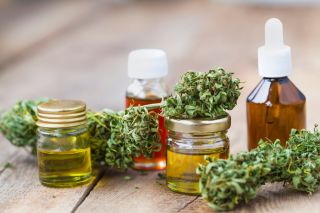 Cannabis buds and small jars of oil.