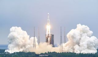A Long March 5B rocket launches Tianhe, the core module of China's new space station, on April 28, 2021.
