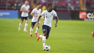 Shaq Moore of USMNT dribbles the ball in world cup qualifying match