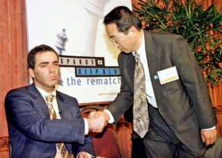 World Chess champion Garry Kasparov barely acknowledges the handshake from Dr. C.J. Tan head of the IBM Deep Blue computer team which defeated Kasparov in the six-game series that ended on May 11, 1997.
