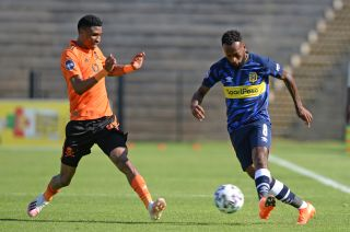 Mpho Makola is challenged by Vincent Pule