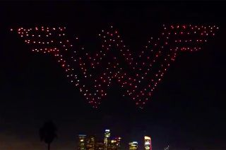 """Look, up in the sky!"" No, it's neither a bird nor a plane — it's hundreds of drones forming the ""Wonder Woman"" logo."