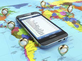 Smartphone on world map