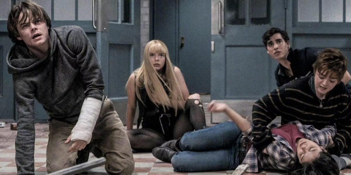 Cannonball, Magik, Sunspot, Wolfsbane and Mirage look terrified as they sit on the ground of the institution in The New Mutants